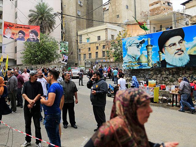 Posters of Hezbollah chief Sheikh Hassan Nasrallah in Beirut, Sunday, May 6, Photo, AP
