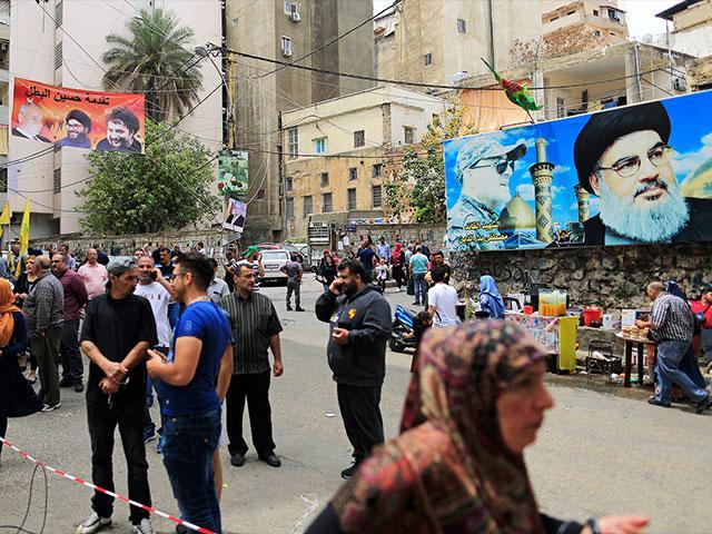 Posters of Hezbollah chief Sheikh Hassan Nasrallah in Beirut, Sunday, May 6, Photo, AP