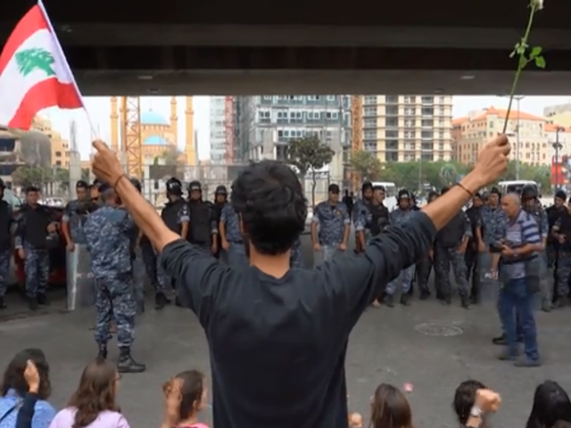 Courtesy AP/ Anti-government protesters block roads in Beirut