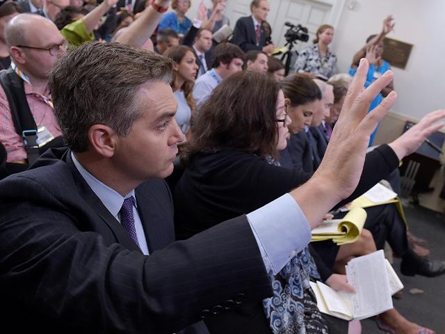 Jim Acosta of CNN raises his hand to ask a question during the daily briefing at the White House in Washington, Wednesday, Aug. 2, 2017. (AP Photo/Susan Walsh)