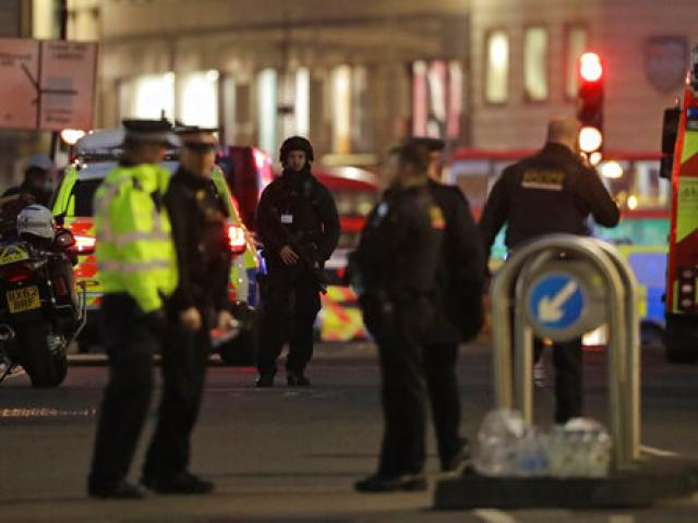 Armed police officers on the north side of London Bridge in London, Friday, Nov. 29, 2019. British police shot a man on London Bridge in the heart of Britain's capital on Friday after a stabbing that left several people wounded