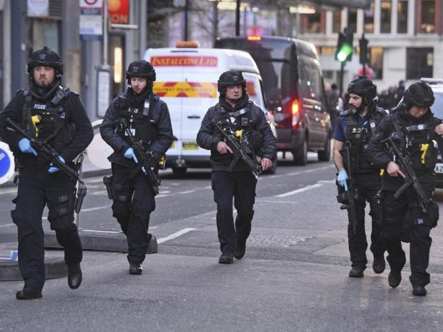 Police on Cannon Street near the scene of a terror attack on London Bridge in central London, Friday, Nov. 29, 2019. (Kirsty O'Connor/PA via AP)