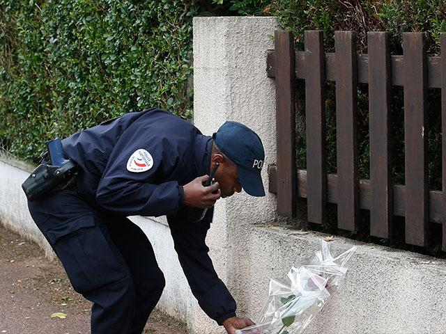 French police officer pays tribute to slain colleagues, Associated Press photo