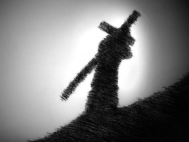 man-carrying-cross