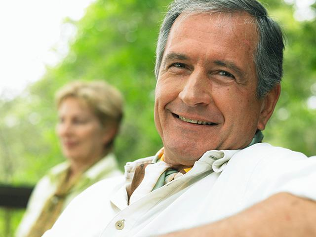 mature-couple-relaxing-outdoors-man-smiling