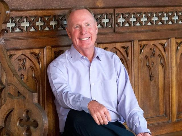 Max Lucado sitting on church pew
