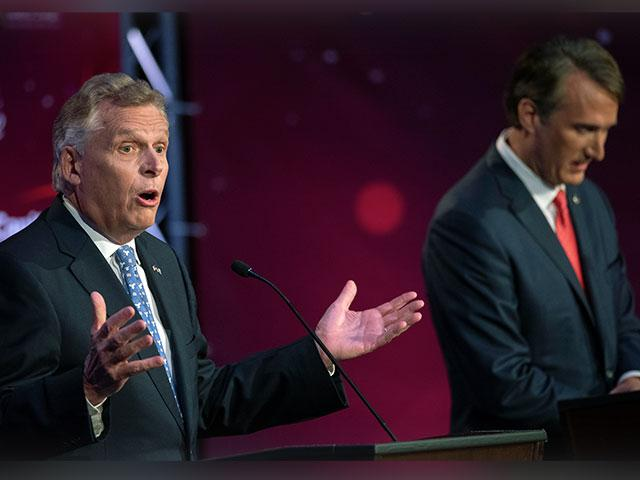 Virginia Democratic gubernatorial candidate and former Gov. Terry McAuliffe, left, and Republican challenger, Glenn Youngkin, participate in a debate at Northern Virginia Community College, in Alexandria, Va., Tuesday, Sept. 28, 2021. (AP Photo/Cliff Owen
