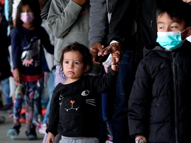 U.S. authorities encountered nearly double the number children traveling alone across the Mexican border in one day this week than on an average day last month, March 17, 2021, in Brownsville, Texas. (AP Photo/Julio Cortez)