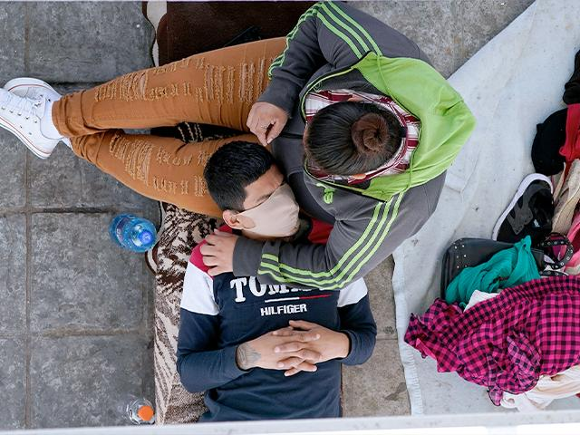 Migrants who were deported after being caught trying to sneak into the U.S. rest under a ramp that leads to the McAllen-Hidalgo International Bridge point of entry into the U.S., March 18, 2021, in Reynosa, Mexico. (AP Photo/Julio Cortez)
