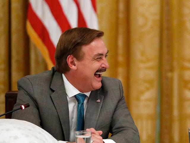 "Michael Lindell, with My Pillow, laughs with President Donald Trump during a ""Made in America,"" roundtable event in the East Room of the White House in Washington, Wednesday, July 19, 2017. (AP Photo/Alex Brandon)"