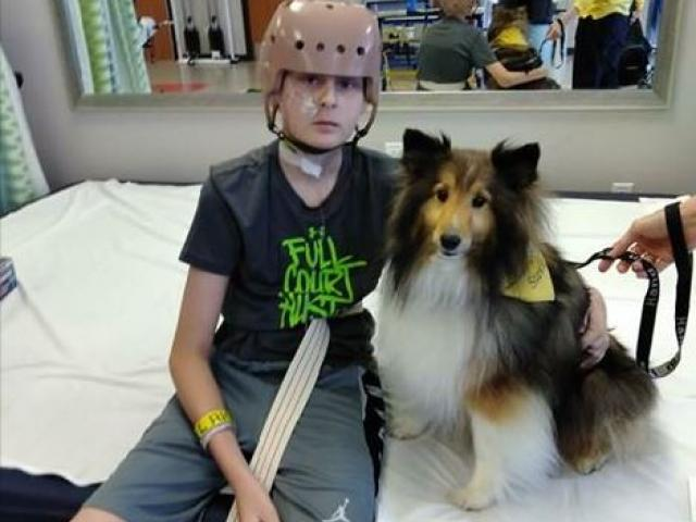 Trenton and Stevie the service dog. Image courtesy: Jennifer Nicole Reindl/Facebook.