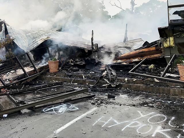 Embers of the First Pentecostal Church in Holly Springs, Miss., May 20, 2020. The church was burned about a month after it filed a lawsuit challenging city restrictions amid the pandemic. (Major Kelly McMillen/Marshall County Sheriff's Office via AP)