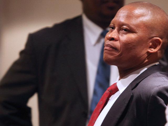 In this photo taken Sunday Sept. 4, 2011 in Cape Town, South Africa, Mogoeng Mogoeng during a break of the Judicial Service Commission Hearing into his nomination for chief justice. AP
