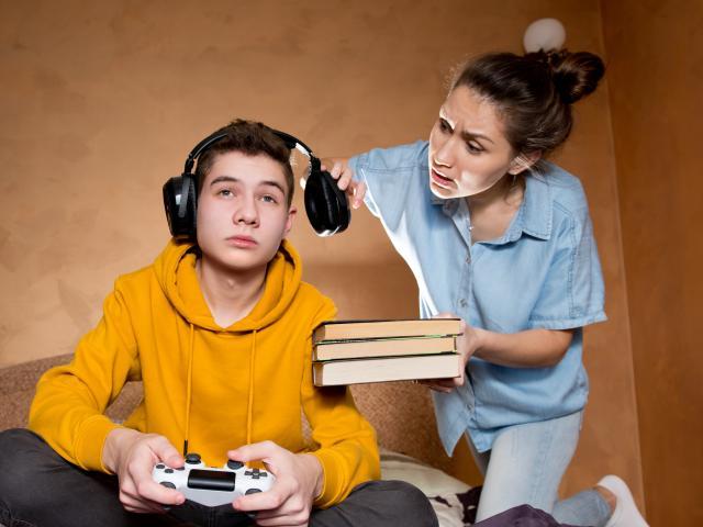 Teen playing games while mom yells