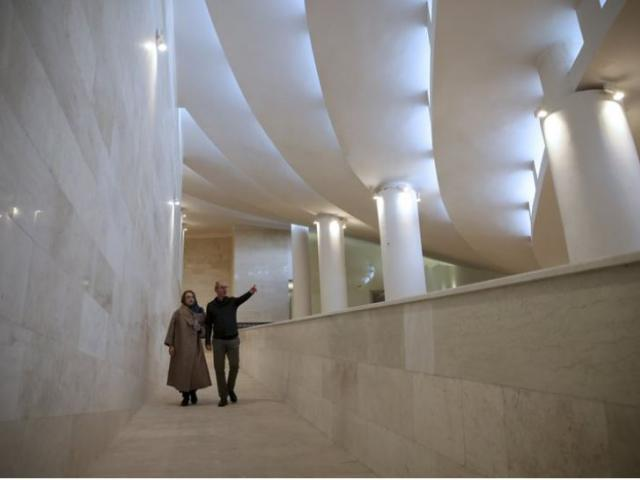 Iranian architects Reza Daneshmir gestures as he talks to his wife and fellow architect Catherine Spiridonoff, the two designers behind the new and unusual Vali-e-Asr mosque in central Tehran.