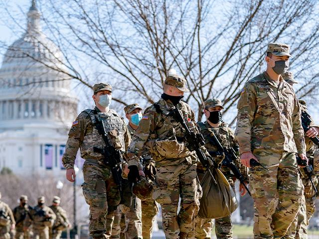 Members of the National Guard patrol outside the Capitol Building on Capitol Hill in Washington, Jan. 14, 2021. (AP Photo/Andrew Harnik)
