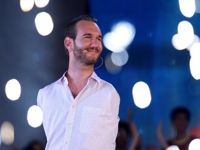 Nick Vujicic, a Christian evangelist who was born with no limbs, greets a crowd of 25,000 young people at My Dinh national stadium in Hanoi, Vietnam. (AP Photo/Na Son Nguyen)