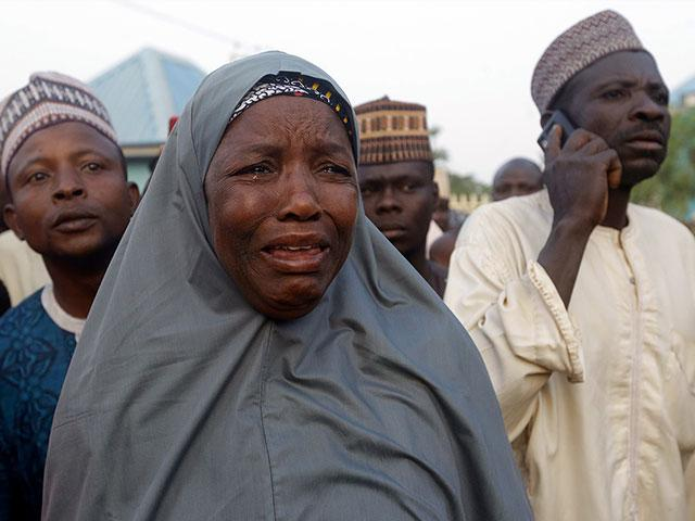 Nigerian families weep after their children were kidnapped from school (AP Photo/Sunday Alamba)