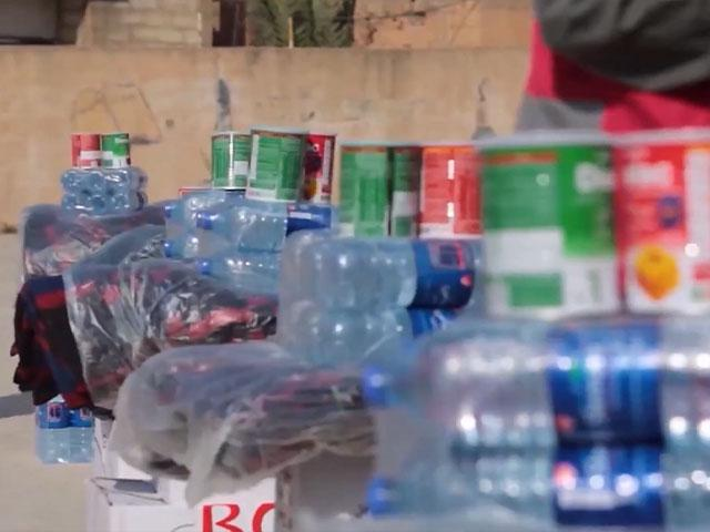 Bottled water is just part of the supplies CBN's Operation Blessing is bringing to Syrian refugees. (Image credit: CBN News)