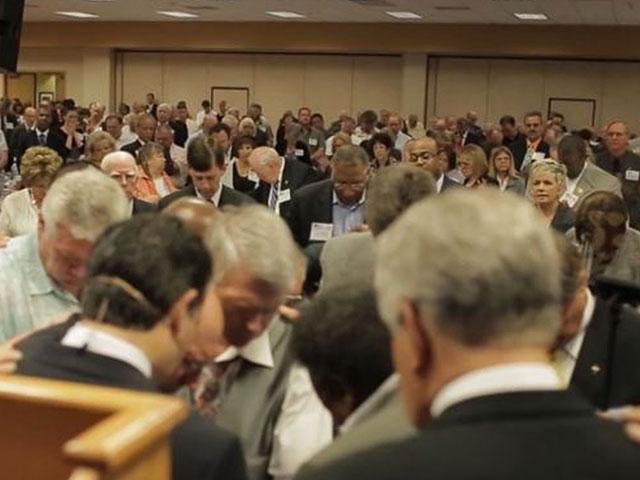 "Screenshot of pastors praying together at a previous ""Pastors and Pews"" event. (Image credit: CBN News)"