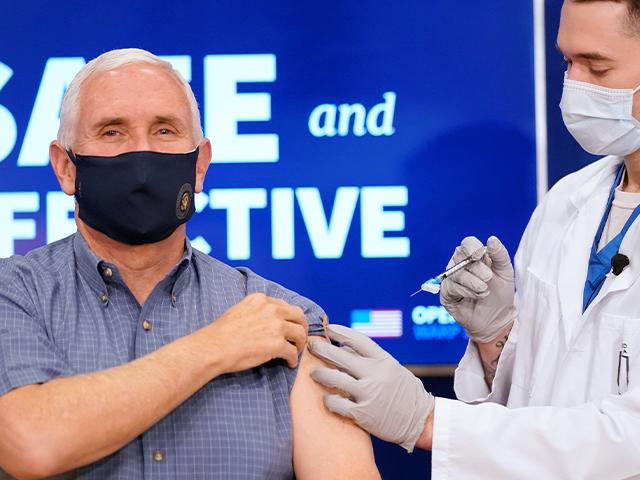 Vice President Mike Pence receives a Pfizer-BioNTech COVID-19 vaccine shot at the Eisenhower Executive Office Building on the White House complex, Dec. 18, 2020. (AP Photo/Andrew Harnik)