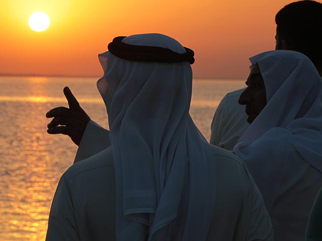 The Persian Gulf at sunset as seen from the western village of Karzakan, Bahrain. (AP Photo/Hasan Jamali)