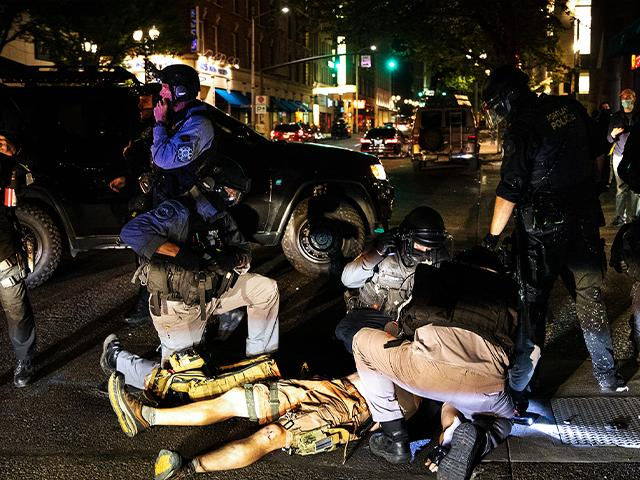 A man was shot dead Aug. 29, 2020, in Portland, Ore. Fights broke out as a caravan of about 600 vehicles was confronted by counterdemonstrators in the city's downtown. (AP Photo/Paula Bronstein)