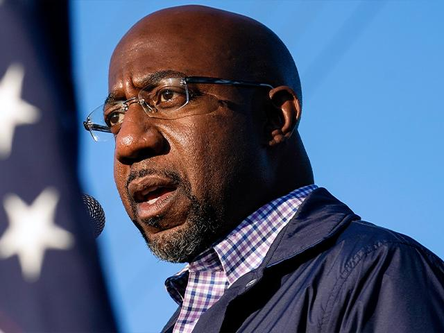 Raphael Warnock, a Democratic candidate for the U.S. Senate, speaks during a campaign rally on Sunday, Nov. 15, 2020, in Marietta, Ga. Warnock and U.S. Sen. Kelly Loeffler are in a runoff election for the Senate seat. (AP Photo/Brynn Anderson)