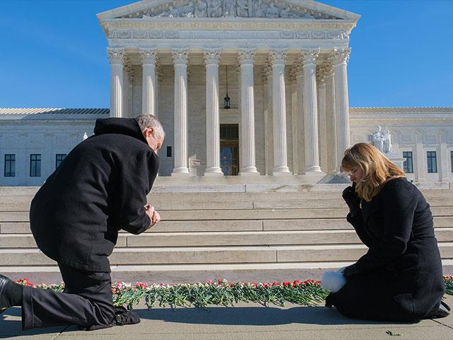 Public lays flowers at US Supreme Court for Tuesday's 'Remembering the Unborn Memorial' (Photo Credit: Patrick Robertson)