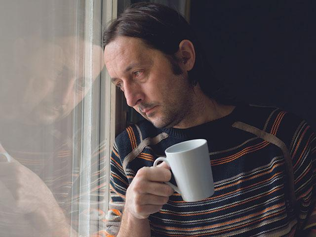 Sad man with coffee