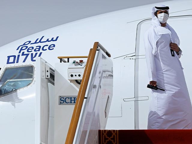 In this Monday, Aug. 31, 2020 file photo, an official stands at the door of an Israeli El Al airliner after it landed in Abu Dhabi, United Arab Emirates.(Nir Elias/Pool Photo via AP, File)