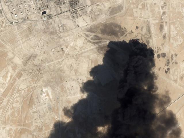 Satellite image from Planet Labs Inc. shows thick black smoke rising from Saudi Aramco's Abqaiq oil processing facility in Buqyaq, Saudi Arabia (Planet Labs Inc via AP)
