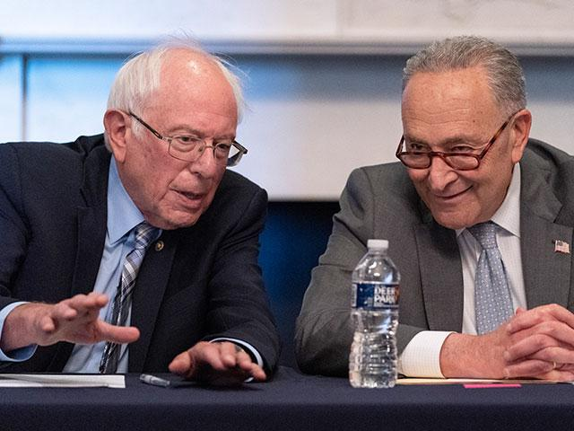 Senate Majority Leader Chuck Schumer of N.Y., right, sits next to Sen. Bernie Sanders, I-Vt., during a meeting with Senate Democrats on the Budget Committee (AP Photo/Jacquelyn Martin)