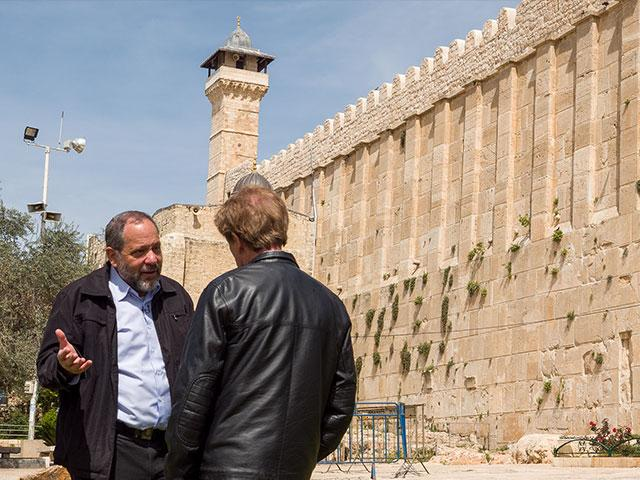 CBN's Scott Ross Speaks with Hebron Jewish Community Spokesman Noam Arnon at the Cave of the Patriarchs, Photo, CBN News, Jonathan Goff