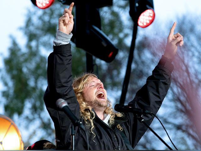 Christian musician Sean Feucht, of California, sings to the crowd during a rally at the National Mall in Washington, Sunday, Oct. 25, 2020. (AP Photo/Jose Luis Magana)