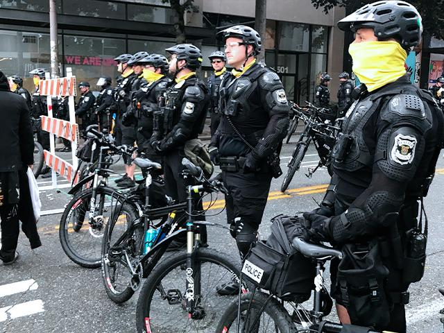 Seattle police block a street with their bikes in the Capitol Hill Organized Protest zone, July 1, 2020. Police in Seattle have torn down demonstrators' tents in the city's occupied protest zone after the mayor ordered it cleared. (AP Photo/Aron Ranen)