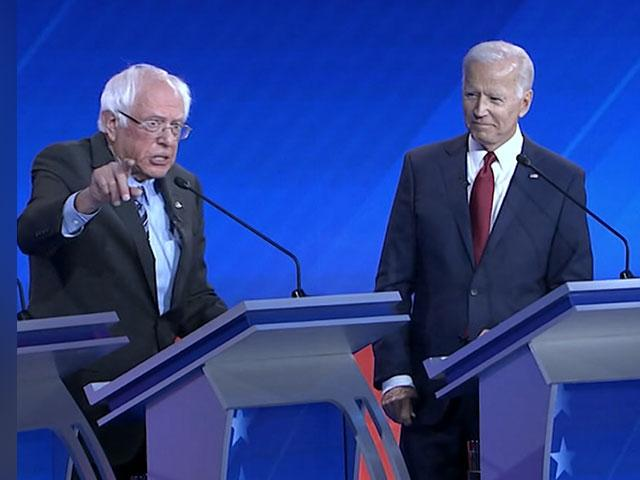 Former Vice President Joe Biden and Sen. Elizabeth Warren (D-MASS) listen to Sen. Bernie Sanders (D-VT) during the third Democratic debate held in Houston, Texas Thursday night. (Image credit: ABC News)