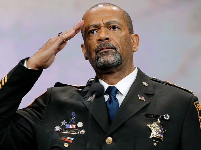 Sheriff David Clarke, Jr., of Milwaukee County, Wisc., salutes the crowd as speaks at the National Rifle Association convention, April 10, 2015, in Nashville, Tenn. (AP Photo/Mark Humphrey)