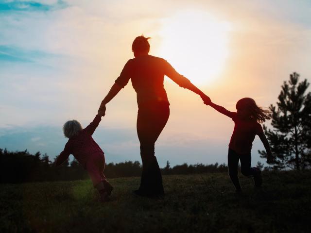 single parent having fun playing with kids