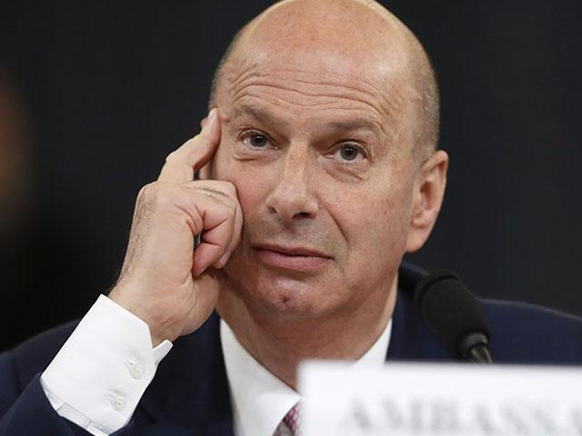 US Ambassador to the European Union Gordon Sondland listens as he testifies before the House Intelligence Committee on Capitol Hill in Washington, Wednesday, Nov. 20, 2019. (AP Photo/Andrew Harnik)
