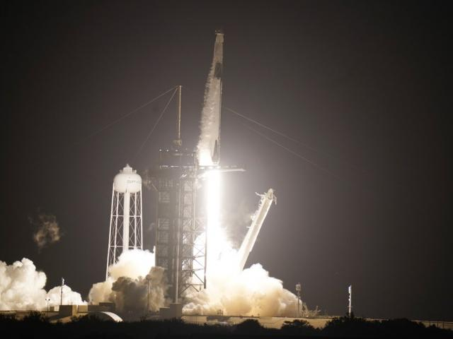 A SpaceX Falcon9 rocket, with the Crew Dragon capsule attached, lift's off from Kennedy Space Center (AP Photo/John Raoux)