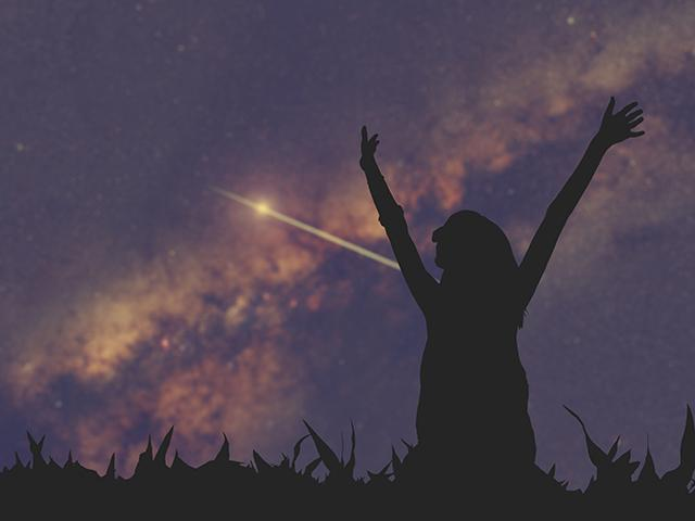 star gazing woman and shooting star