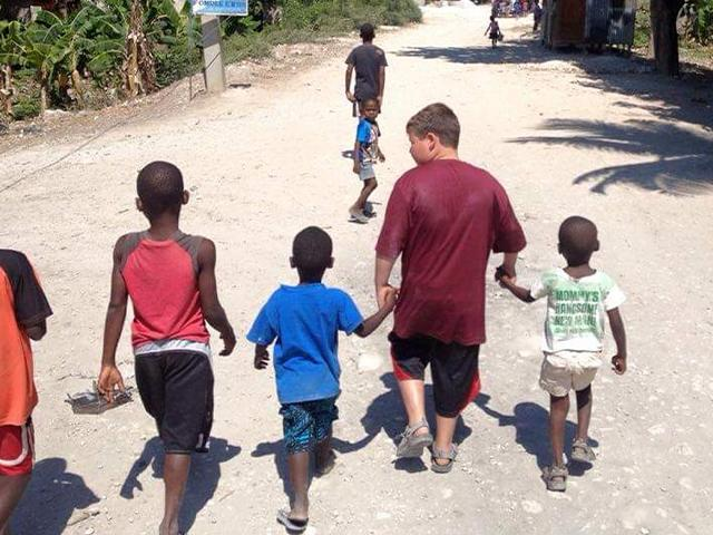 Boys walking in Haiti