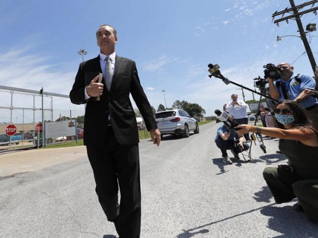 Pastor Tony Spell walks to his church bus as he leaves East Baton Rouge Parish jail on April 21, 2020 (AP Photo/Gerald Herbert)