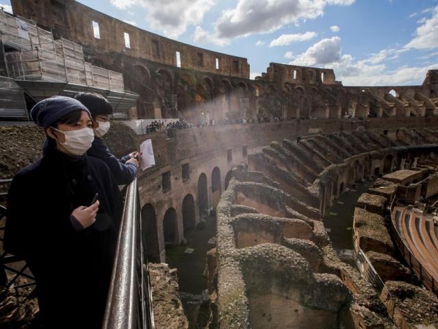 Tourists visit the Colosseum, in Rome, Saturday, March 7, 2020. (AP Photo/Andrew Medichini)