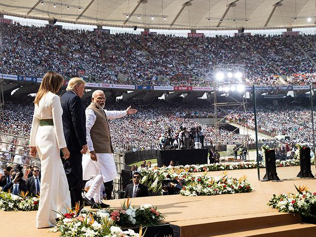 """Donald Trump, first lady Melania Trump, and Indian Prime Minister Narendra Modi arrive for a """"Namaste Trump,"""" event on Monday, Feb. 24, 2020, in Ahmedabad, India. (AP Photo/Alex Brandon)"""