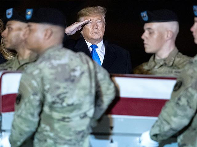 President Donald Trump and first lady Melania Trump watch as a U.S. Army carry team moves a transfer case containing the remains of Chief Warrant Officer 2 David C. Knadle, of Tarrant, Texas, Thursday, Nov. 21, 2019, at Dover Air Force Base, Del.