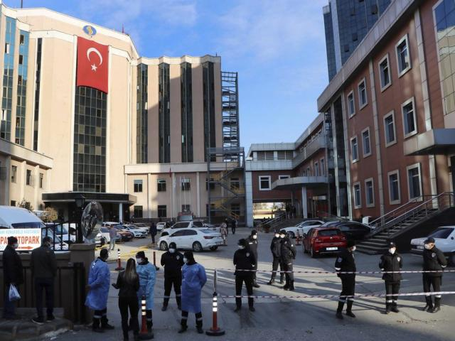 Police and medics gather outside the privately-run Sanko University Hospital in Gaziantep, southeastern Turkey, Saturday, Dec. 19, 2020 (Kadir Gunes/DHA via AP)