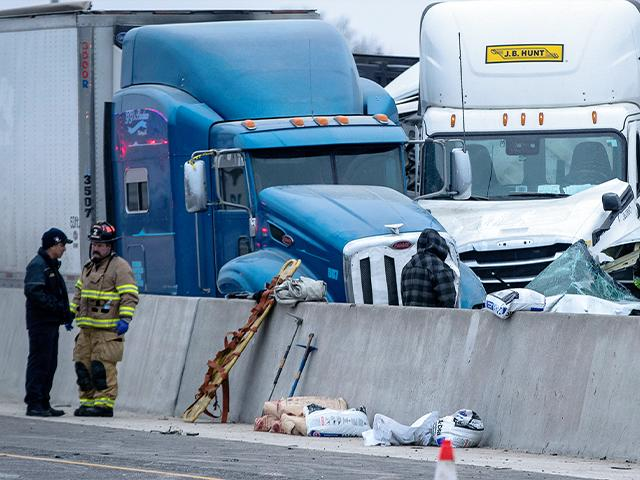 First responders cleanup after a massive pileup on I-35W Thursday, Feb. 11, 2021, near downtown Fort Worth, Texas. At least six people were killed and dozens injured