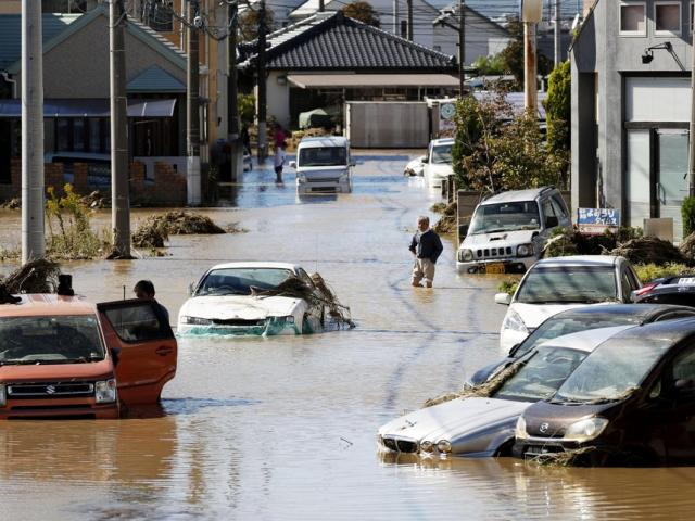 Vehicles are seen in mud water as Typhoon Hagibis hit the city in Sano, Tochigi prefecture, Sunday, Oct. 13, 2019 (Kyodo News via AP)